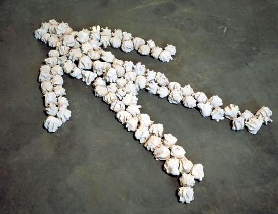 """Alighiero Boetti. Io che prendo il sole a Torino il 19 gennaio 1969 (Me sunbathing in Turin 19 January 1969). 1969. 101 concrete stones, 69 11/16 x 35 7/16"""" (177 x 90 cm). Private collection, Turin. © 2011 Artists Rights Society (ARS), New York/SIAE, Rome"""