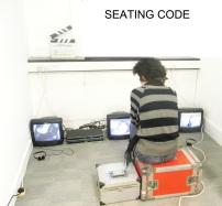 Hong Yane Wang (China) Seating Code, 2010, vídeo, cor, som, 2'20''