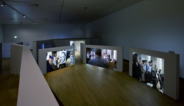 Aernout Mik: Communitas Installation view at Stedelijk Museum, Amsterdam, 2013 Photo: Gert Jan van Rooij (via Art News)