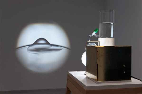 Francisco Tropa, Lantern, 2012. Brass cube, transformer, ventilator, condenser and halogen light bulb, lens. Photo: Marcus Schneider. Courtesy Galerija Gregor Podnar, Berlin / Ljubljana.